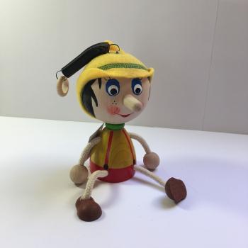 Pinocchio na pružině velká hlava