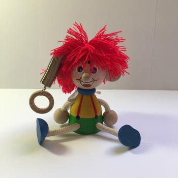Vlasatec s červenými vlasy na pružině